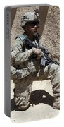 U.s. Army Soldier Takes A Knee While Portable Battery Charger