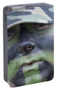 U.s. Army Soldier Wearing Camouflage Portable Battery Charger