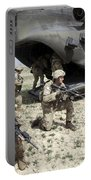 U.s. Army Soldiers Board A Ch-47 Portable Battery Charger