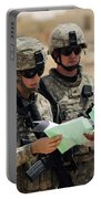 U.s. Army Soldiers Talking With A Town Portable Battery Charger by Stocktrek Images