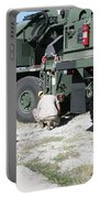U.s. Marine Works On A Kalmar Rough Portable Battery Charger