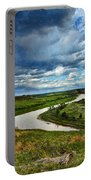 View Of River With Storm Clouds Portable Battery Charger