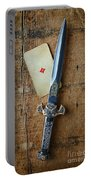Vintage Dagger On Wood Table With Playing Card Portable Battery Charger