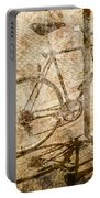 Vintage Looking Bicycle On Brick Pavement Portable Battery Charger