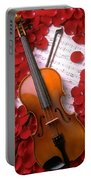 Violin On Sheet Music With Rose Petals Portable Battery Charger