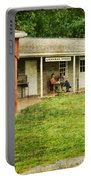Waiting By The General Store Portable Battery Charger by Paul Ward