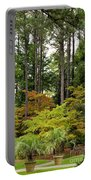 Walking Through An Autumn Garden Portable Battery Charger