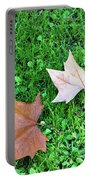 Wet Leaves On Grass Portable Battery Charger