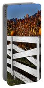 White Fence With Pumpkins Portable Battery Charger
