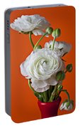 White Ranunculus Close Up In Red Vase Portable Battery Charger