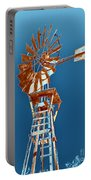 Windmill Rust Orange With Blue Sky Portable Battery Charger by Rebecca Margraf