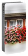 Windows With Red Flowers Portable Battery Charger