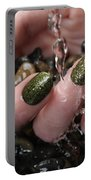 Woman Hand With Fancy Nail Polish In Water Portable Battery Charger