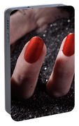 Woman Hand With Red Nail Polish Buried In Black Sand Portable Battery Charger