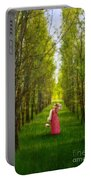 Woman In Vintage Pink Dress Walking Through Woods Portable Battery Charger