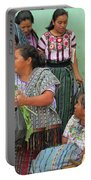 Women At The Chichicastenango Market Portable Battery Charger