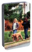 Women Walking A Dog Portable Battery Charger