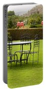 Wrought Metal Chairs Around A Table In A Lawn Portable Battery Charger