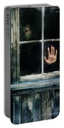 Young Woman Looking Through Hole In Window Portable Battery Charger by Jill Battaglia