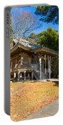 Zen Building In A Garden At A Sunny Morning Portable Battery Charger