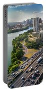 Aerial View Of The Austin Skyline As Rush Hour Traffic Picks Up On I-35 Portable Battery Charger