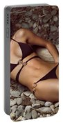 Beautiful Young Woman In Black Bikini On A Pebble Beach Portable Battery Charger