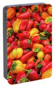Close Up View Of Small Bell Peppers Of Various Colors Portable Battery Charger