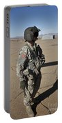 Crew Chief Of A Ch-47 Chinook Stands Portable Battery Charger