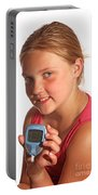 Diabetic Child With Blood Glucose Tester Portable Battery Charger