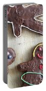 Handmade Decorated Gingerbread People Lying On Wooden Table Portable Battery Charger