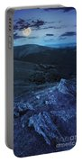 Light On Stone Mountain Slope With Forest At Night Portable Battery Charger