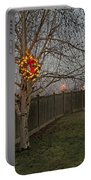 Lit Christmas Wreath Hanging In Tree Portable Battery Charger