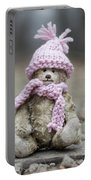 Little Teddy Bear Sitting In Knitted Scarf And Cap In The Winter Forest Between The Rails Portable Battery Charger