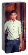 Portrait Of Young Businessman. Portable Battery Charger