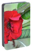 Red Rose On Natural Background With Green Leaves. Portable Battery Charger