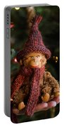 Silly Old Monkey Toy In A Child Hands Under The Christmas Tree Portable Battery Charger