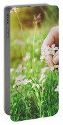 Woman Picking Up Flowers On A Meadow, Hand Close-up. Vintage Light Portable Battery Charger