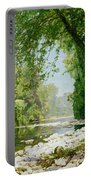 Wooded Riverscape Portable Battery Charger by Leopold Rolhaug