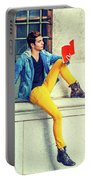 Young Man Reading Red Book, Sitting On Street Portable Battery Charger