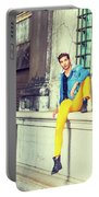 Young Man Relaxing On Street Portable Battery Charger