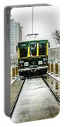 Streetcar Waiting For Passengers In Snowstrom In Uptown Charlott Portable Battery Charger