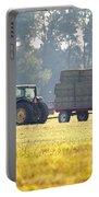 Hauling Hay At Dusk Portable Battery Charger