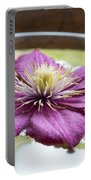 Clematis Flower On Water Portable Battery Charger