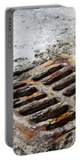 Old Rusty Street Grate Near The Sea In Cres Portable Battery Charger