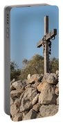 Rosary Hanging On A Small Wooden Cross On A Stone Wall Portable Battery Charger