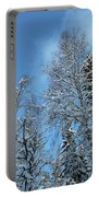 Snowy Trees Against A Blue Sky Portable Battery Charger