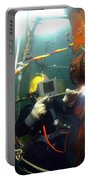 U.s. Navy Diver Welds A Repair Patch Portable Battery Charger