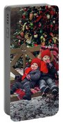Two Children Sitting On A Bench With Candy Portable Battery Charger