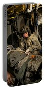 U.s. Army Specialist Practices Giving Portable Battery Charger