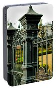 5603 St. Charles Ave Fence- Nola Portable Battery Charger